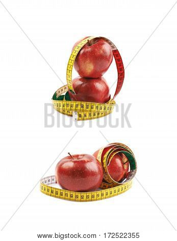 Two ripe red apples tied with yellow measuring tape as a fitness composition isolated over the white background, set of two different foreshortenings