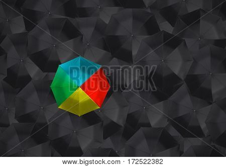 colorful umbrella and many black umbrellas. business leader different concept.
