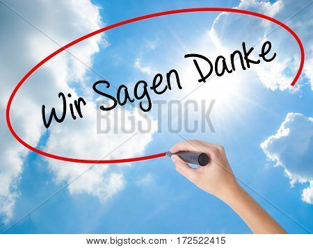 Woman Hand Writing Wir Sagen Danke (we Say Thank You In German)   With Black Marker On Visual Screen