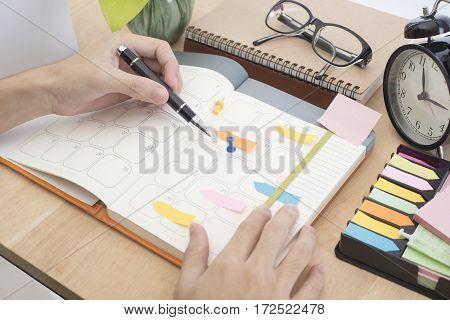 business hand write calender planner meeting on desk office. organization management remind concept.