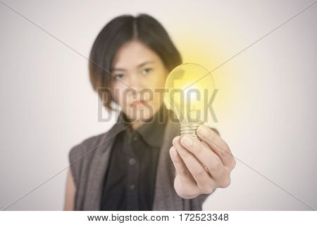Business women hand holding light bulb concept of new ideas with innovation and creativity.