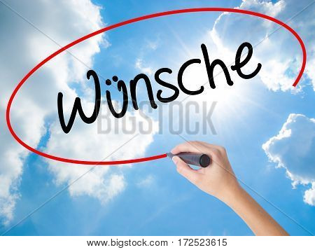 Woman Hand Writing Wunsche (wishes In German) With Black Marker On Visual Screen