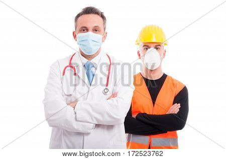 Male Doctor And Constructor Both Standing With Arms Crossed