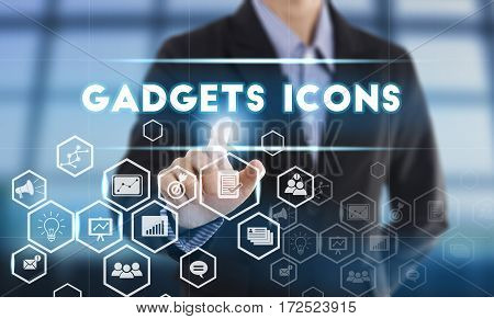 Businessman hand chooses Gadgets icons wording on interface screen. internet technology service concept. can used for cover page presentation and web banner.