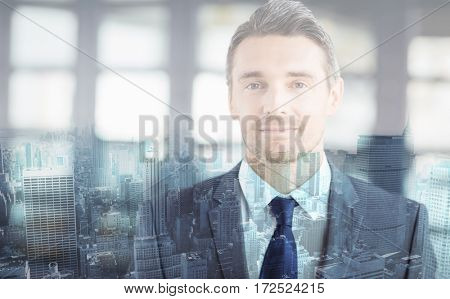 Close-up portrait of confident handsome businessman in office