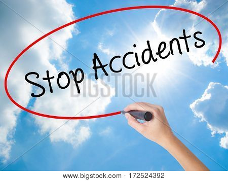 Woman Hand Writing Stop Accidents With Black Marker On Visual Screen