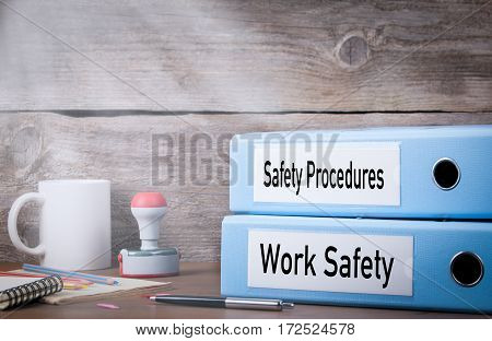 Work Safety and Safety Procedures. Two binders on desk in the office. Business background.
