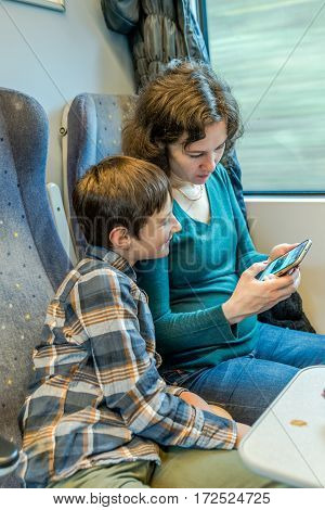 Travel concept of mother and son on train journey.