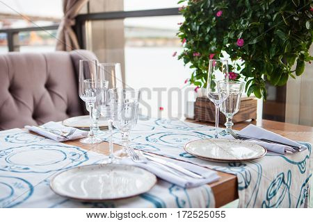 Cafe Table served with Flowers in summer day
