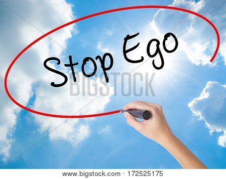 Woman Hand Writing  Stop Ego With Black Marker On Visual Screen