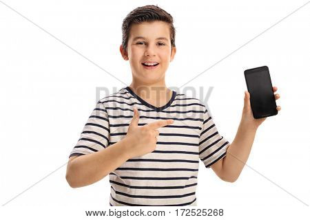 Joyful boy holding a phone and pointing isolated on white background