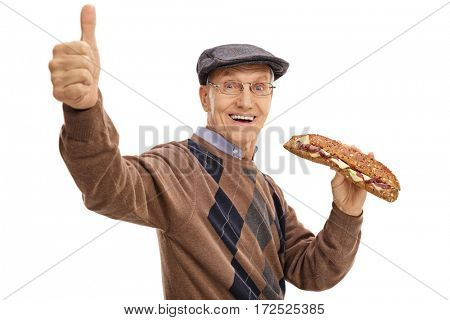 Joyful elderly man having a sandwich and making a thumb up sign isolated on white background