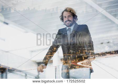 Portrait of happy businessman standing in office