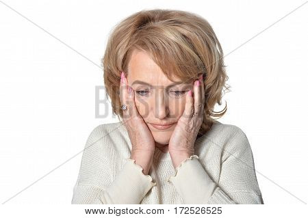 Closeup portrait, morose elderly lady, downcast gloomy, resting face on hands isolate on white