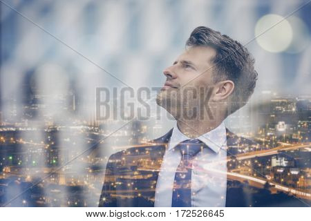 Close up of thoughtful businessman looking up