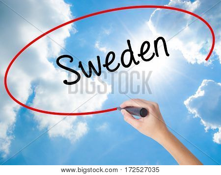 Woman Hand Writing Sweden  With Black Marker On Visual Screen