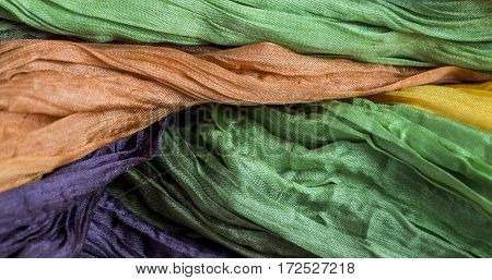 colored crinkled crumpled silk fabric textured for background