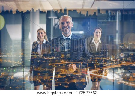 Portrait of business colleagues walking together in office corridor