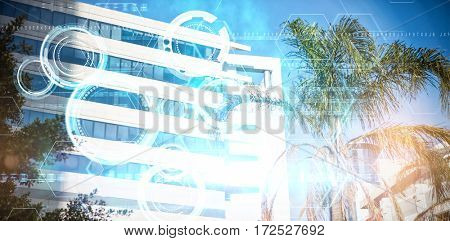 Blue and black technology dial design against tree by glass building