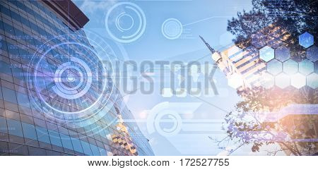 Residential buildings against sky against futuristic technology interface