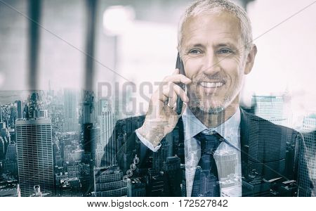 Businessman talking on mobile phone in the office