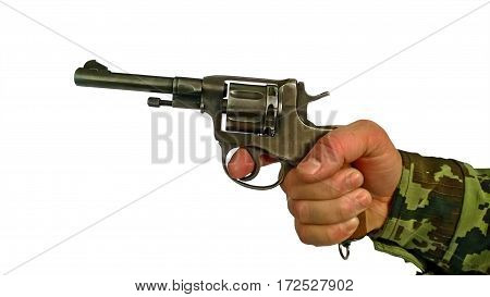 Old revolver in the right man's hand which finger on the trigger before firing the shot