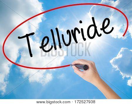 Woman Hand Writing Telluride With Black Marker On Visual Screen