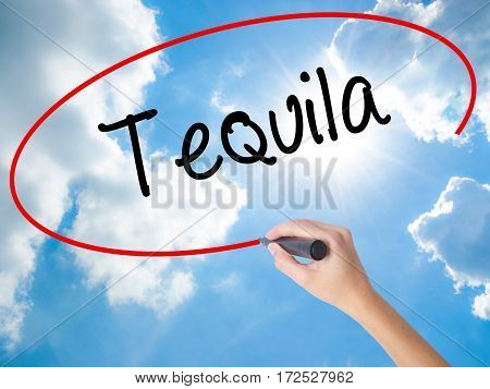 Woman Hand Writing Tequila With Black Marker On Visual Screen
