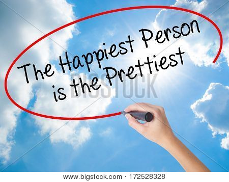 Woman Hand Writing The Happiest Person Is The Prettiest With Black Marker On Visual Screen.