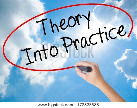 Woman Hand Writing Theory Into Practice With Black Marker On Visual Screen