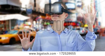 Businesswoman experiencing virtual reality against blurry new york street