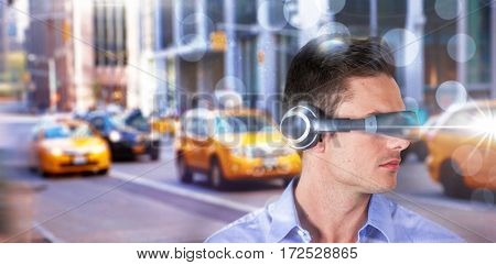 Handsome young man with virtual reality simulator against blurry new york street