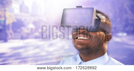 Happy man using virtual reality headset against blurred new york street