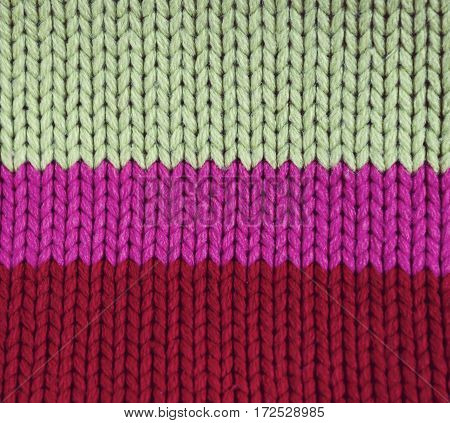 knitted colorful textured background includes 3 colors
