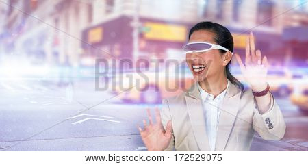 Happy businesswoman wearing virtual video glasses against blurred new york street