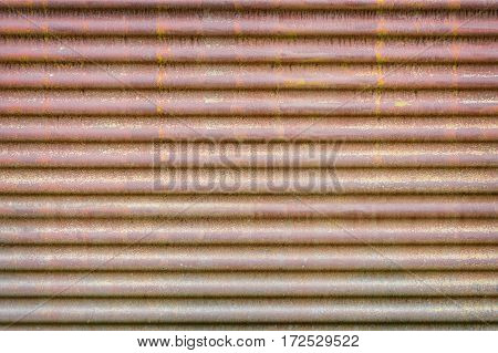 horizontal wavy background texture of old rusty corrugated metal sheet