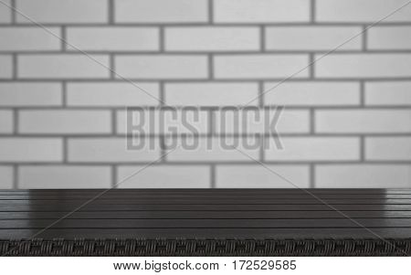Blurred and abstract background. Empty wooden tabletop and defocused brick wall background for display or montage your products.