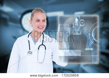 Female doctor touching something against interior view of operating room 3d