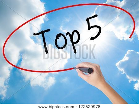 Woman Hand Writing Top 5 With Black Marker On Visual Screen