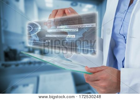 Midsection of female doctor using digital tablet against doctor scanning patient on machine 3d