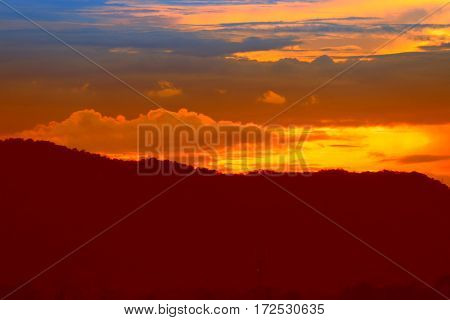 sunset in sky and cloud beautiful colorful twilight time with mountain silhouette