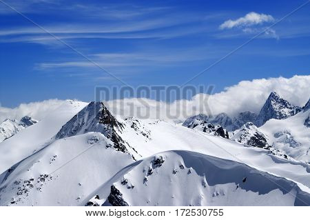 Winter Mountains With Snow Cornice And Blue Sky With Clouds In Nice Winter Day