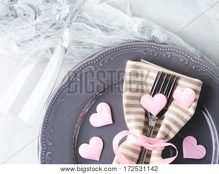 Romantic dinner date plates hearts love symbol with champagne glasses on gray. Valentine's woman day