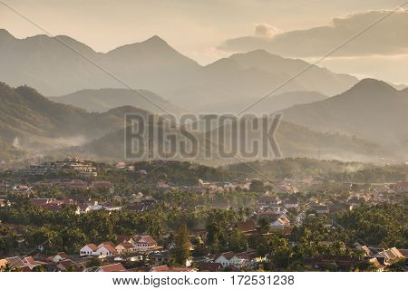 Top view of Luang Prabang from Phousi Mountain during sunset.