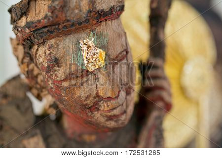 Close-up wooden statue in Wat Chedi Kaew Thaton temple in Chiangmai province, Thailand