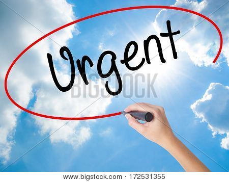 Woman Hand Writing Urgent With Black Marker On Visual Screen.