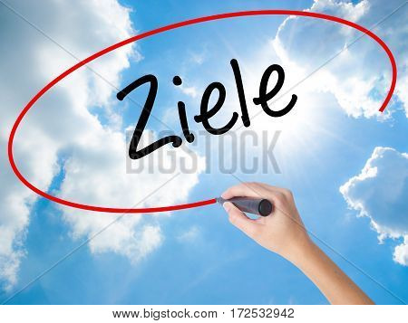 Woman Hand Writing Ziele  (goalsin German) With Black Marker On Visual Screen