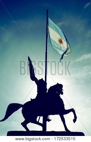 The Equestrian monument to General Manuel Belgrano a landmark of Buenos Aires and the Argentinian Flag in Buenos Aires Argentina. It is located at Plaza de Mayo in front of the Casa Rosada
