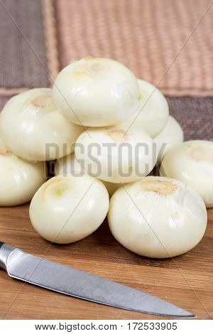 Cleaned And Peeled Onions On The Cutting Board