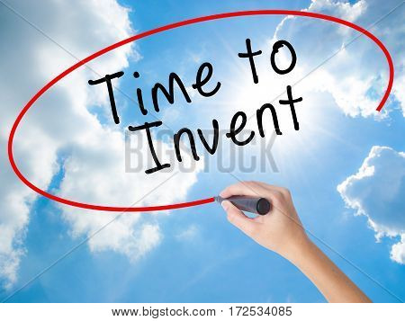 Woman Hand Writing Time To Invent With Black Marker On Visual Screen